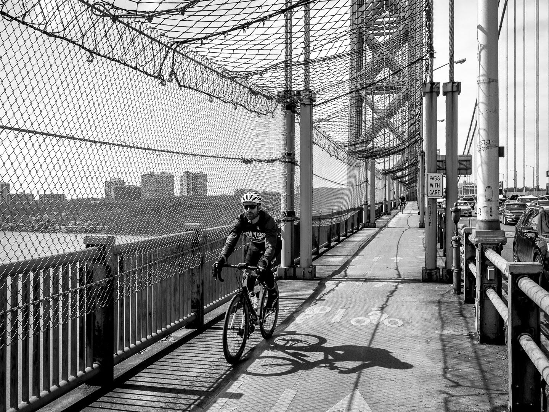 Cyclist using the sidewalk for training