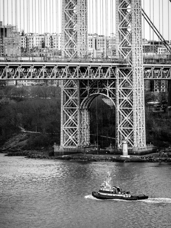 A ship passes under George Washington Bridge